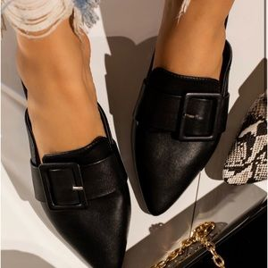 Black mules with details